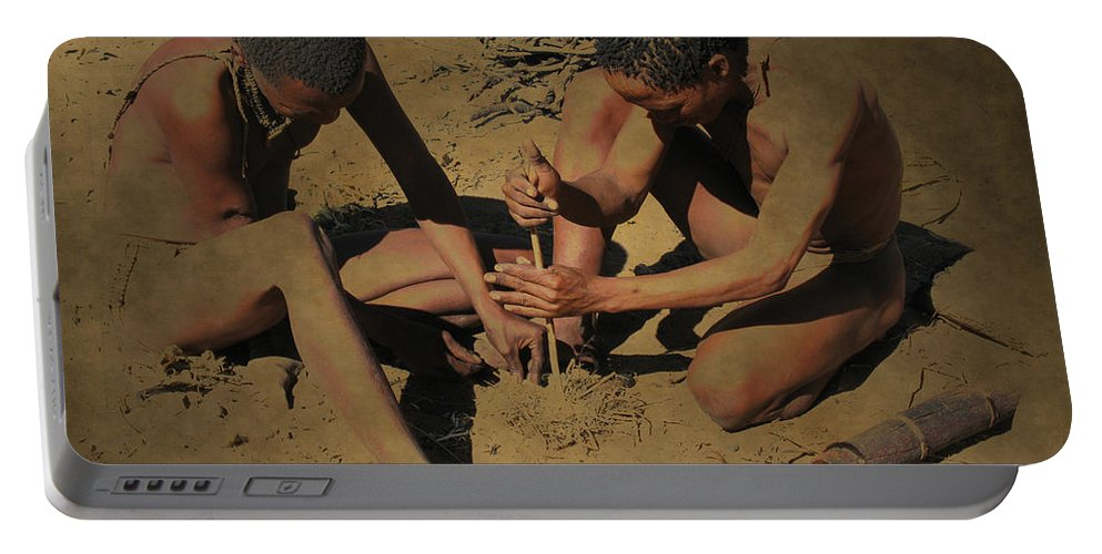 Fire Portable Battery Charger featuring the photograph Making Fire by Doug Matthews