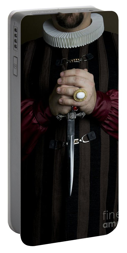 Man Portable Battery Charger featuring the photograph Man In Baroque Outfits Holding A Silver Dagger by Jaroslaw Blaminsky