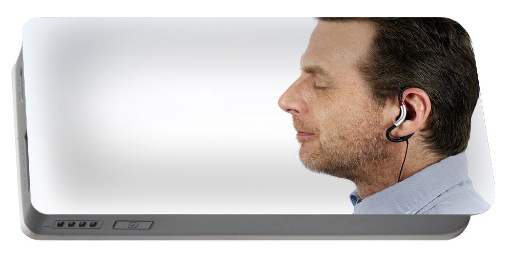 Music Portable Battery Charger featuring the photograph Man Listening To Music by Lee Serenethos