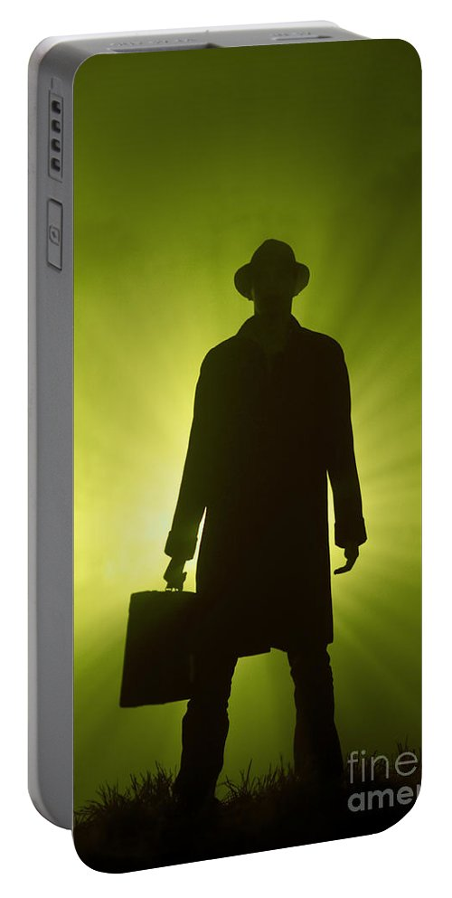 Man Portable Battery Charger featuring the photograph Man With Case In Green Light by Lee Avison