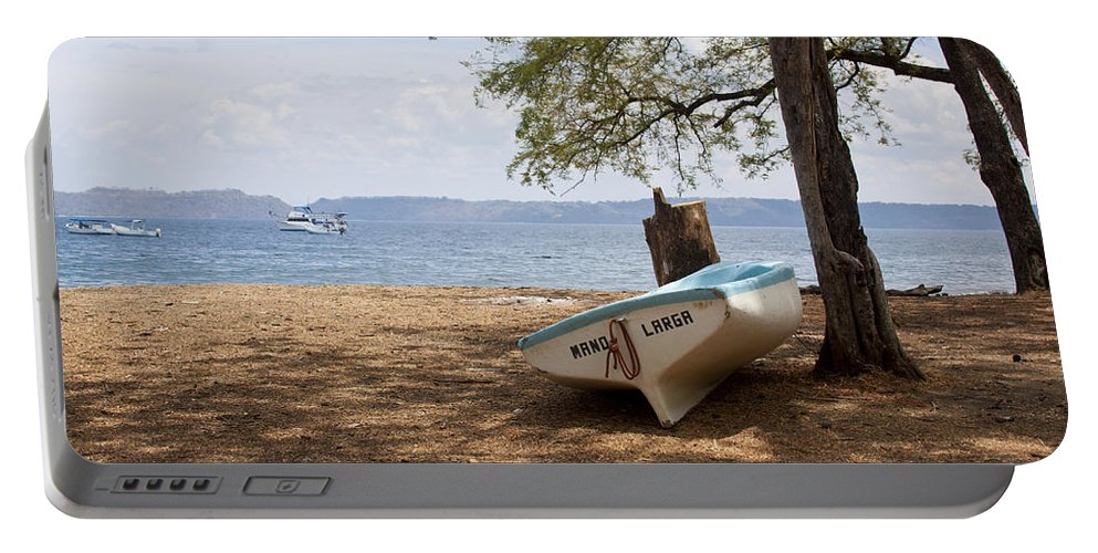 Boat Portable Battery Charger featuring the photograph Mano Larga by Jean Macaluso