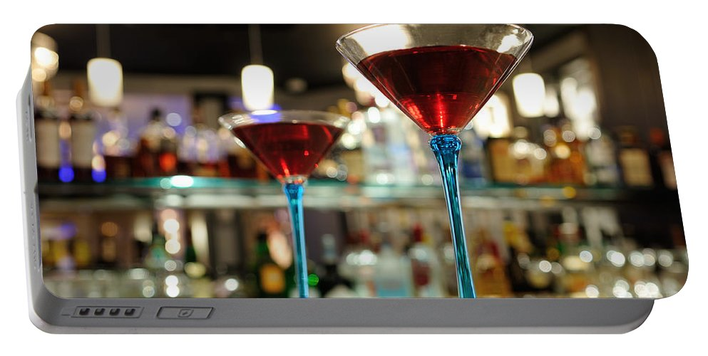 Bar Counter Portable Battery Charger featuring the photograph Martini Glasses In Bar by Patrick Herrera