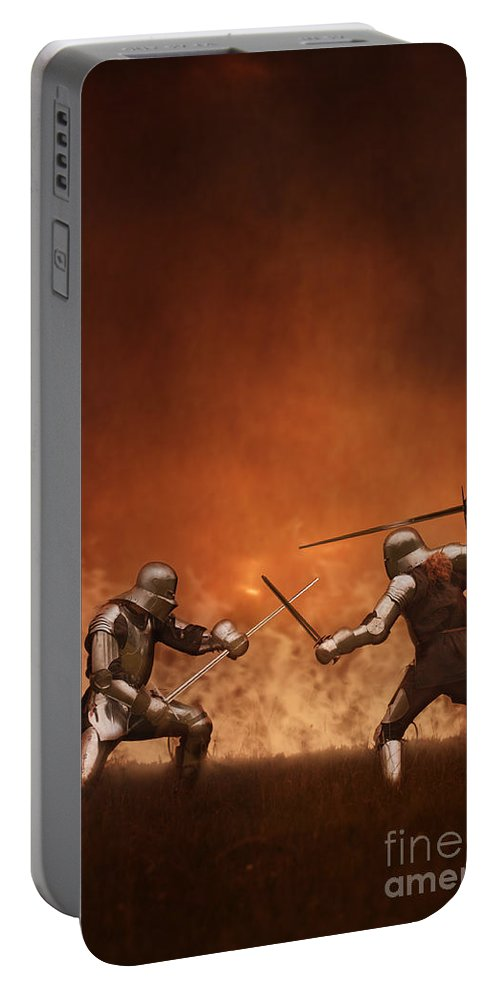 Knight Portable Battery Charger featuring the photograph Medieval Knights In Armour Fighting With Swords by Lee Avison
