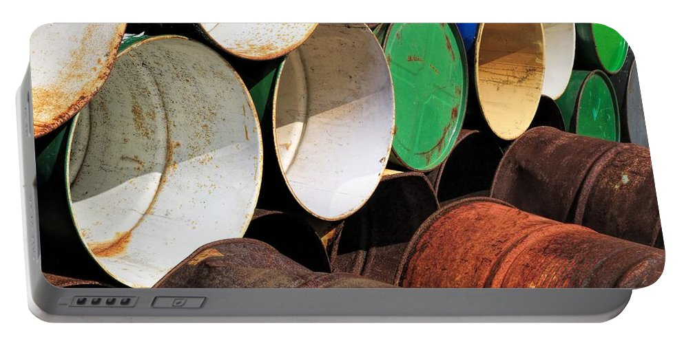 Abandoned Portable Battery Charger featuring the photograph Metal Barrels 1 by Rudy Umans