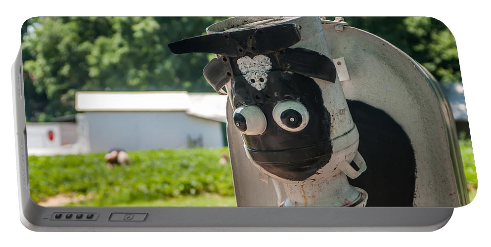 Animal Portable Battery Charger featuring the photograph Metal Cow On Farm by Alex Grichenko