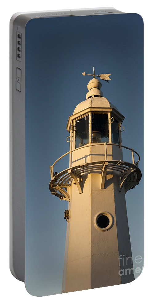 Autumn Portable Battery Charger featuring the photograph Mevagissey Lighthouse In The Evening by Anne Gilbert