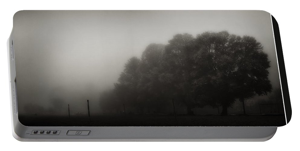 Atmosphere Portable Battery Charger featuring the photograph Misty Trees In Early Morning Fog by Peter v Quenter