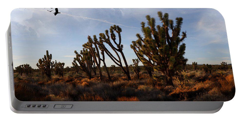 Evie Portable Battery Charger featuring the photograph Mojave Desert Joshua Tree With Ravens by Evie Carrier