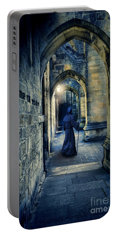 Monk Portable Battery Charger featuring the photograph Monk In A Dark Corridor by Jill Battaglia