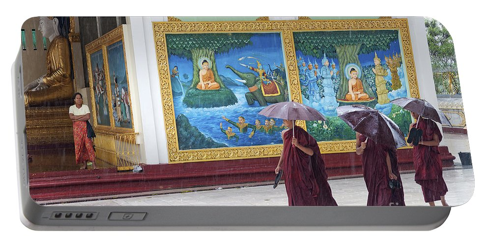 Asia Portable Battery Charger featuring the photograph Monks In Rain At Shwedagon Paya Temple Yangon Myanmar by Jacek Malipan