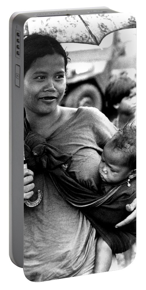 Montagnard Portable Battery Charger featuring the photograph Montagnard Woman With Umbrella And Child by Norman Johnson