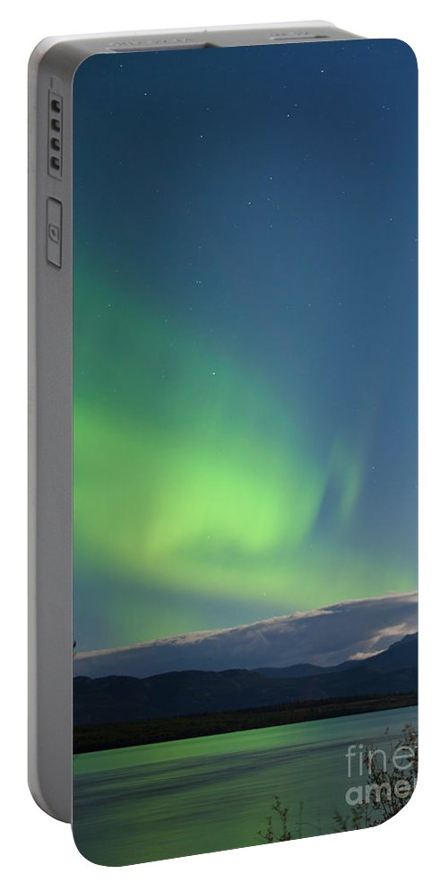 Astronomy Portable Battery Charger featuring the photograph Moon-lit Clouds Northern Lights Over Lake Laberge by Stephan Pietzko