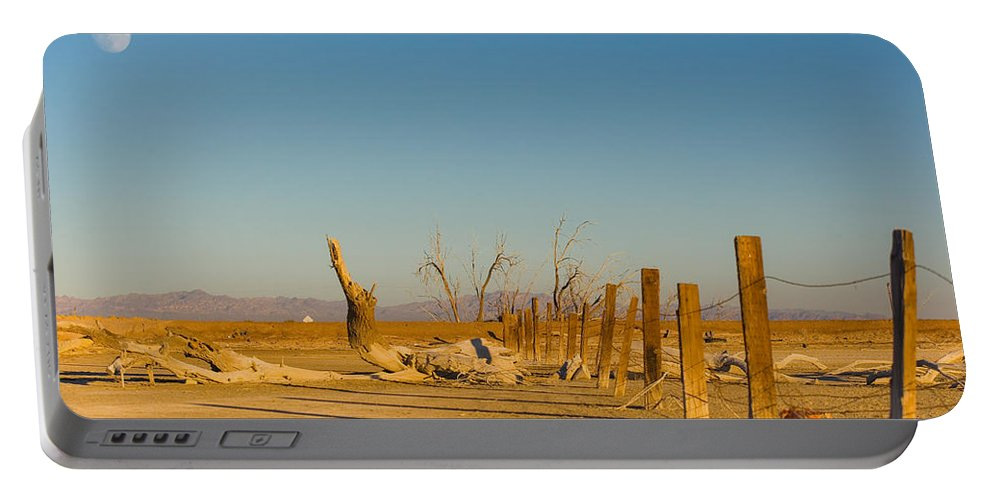 Abandoned Portable Battery Charger featuring the photograph Moon Rise Over Waste Land by Scott Campbell