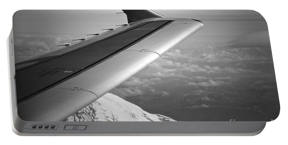 Plane Portable Battery Charger featuring the photograph Mountain Climbing by Gwyn Newcombe