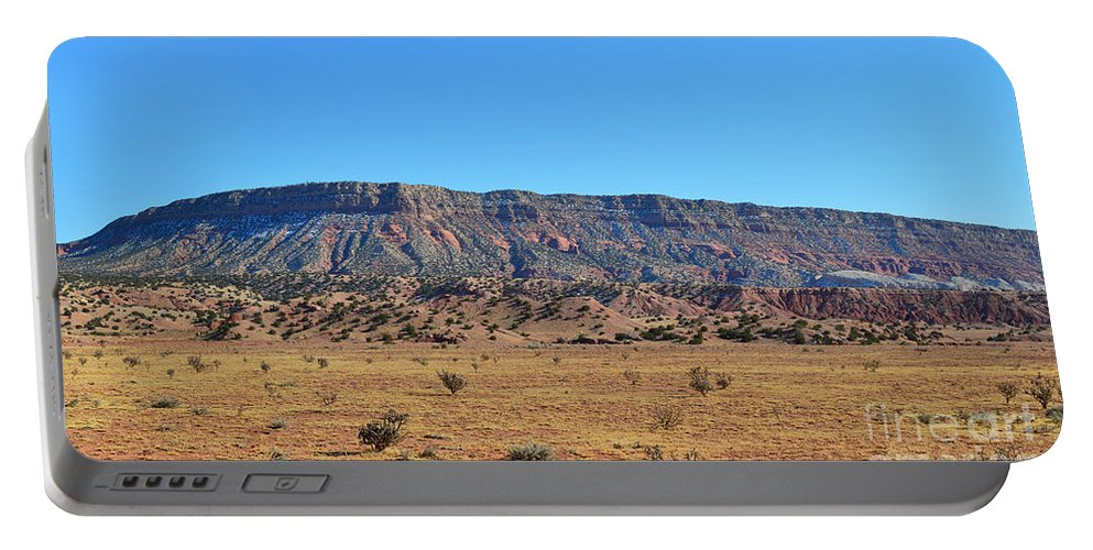 Mountain Portable Battery Charger featuring the photograph Mountain Over The Plains by Meandering Photography