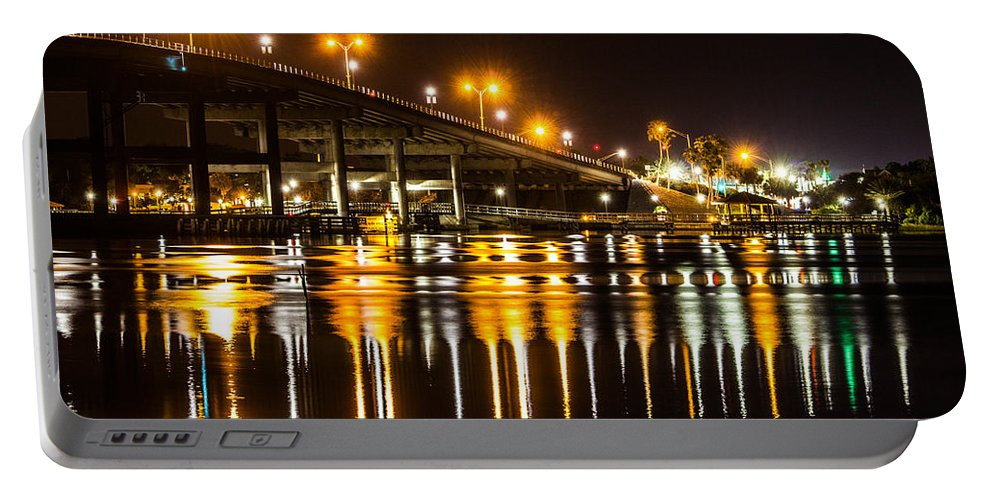 Nighttime Portable Battery Charger featuring the photograph Moving Reflection by Tyson Kinnison