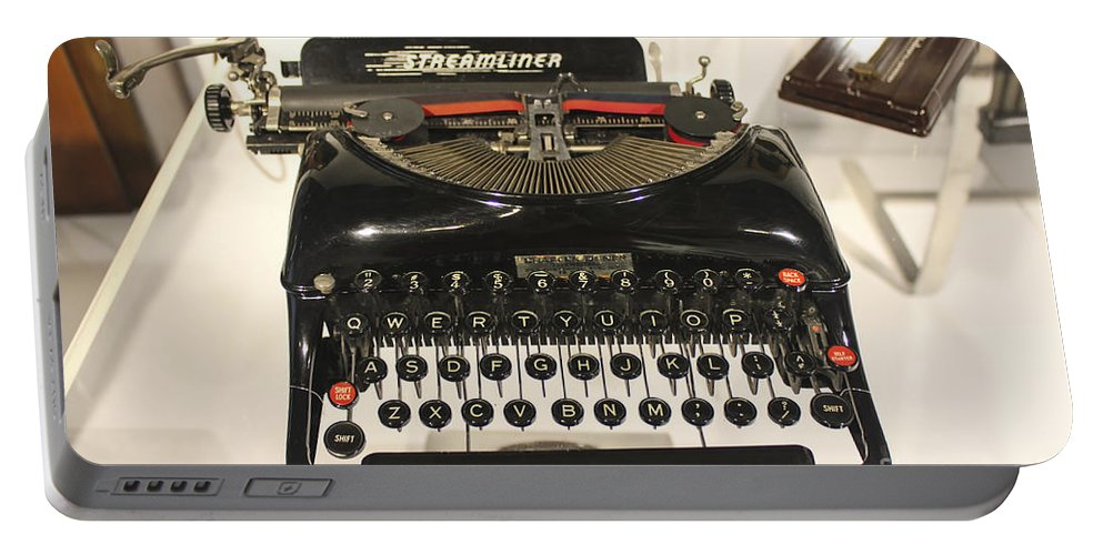 Remington Typewriter Portable Battery Charger featuring the photograph Museum Series 67 by Carlos Diaz
