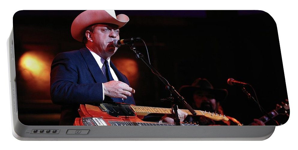 Portable Battery Charger featuring the photograph Musician Junior Brown by Concert Photos
