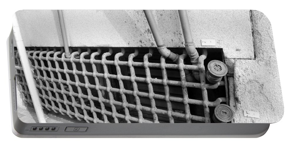 Macro Portable Battery Charger featuring the photograph N Y C Grates In Black And White by Rob Hans