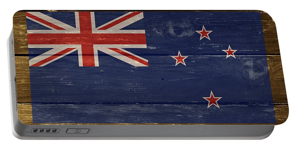 New Zealand Portable Battery Charger featuring the digital art New Zealand National Flag On Wood by Movie Poster Prints