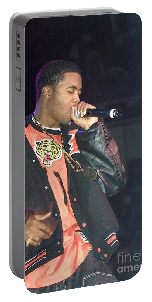 Singer Portable Battery Charger featuring the photograph Naz by Concert Photos