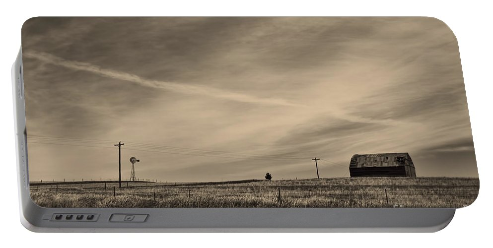 Nebraska Portable Battery Charger featuring the photograph An Abandoned Nebraska Barn by Steve Triplett