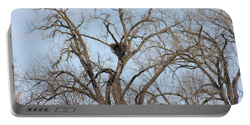 Eagle Nest Portable Battery Charger featuring the photograph Nested by Susan Herber