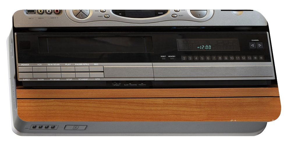 New Portable Battery Charger featuring the photograph New Dvr With Old Vcr by Lee Serenethos