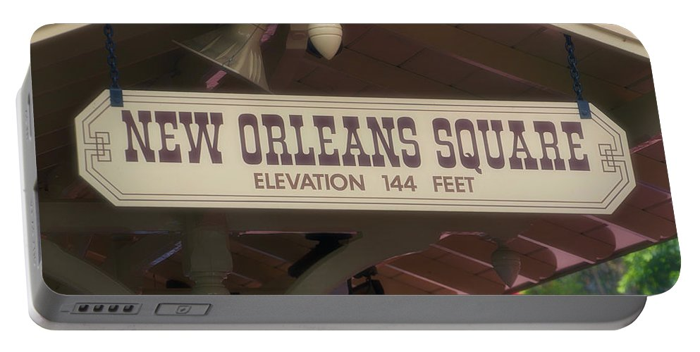 Disney Portable Battery Charger featuring the photograph New Orleans Signage Disneyland by Thomas Woolworth