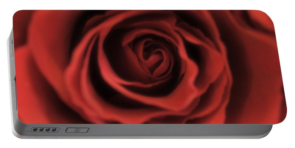 Red Portable Battery Charger featuring the photograph Close Up Heart Of A Red Rose by Toula Mavridou-Messer
