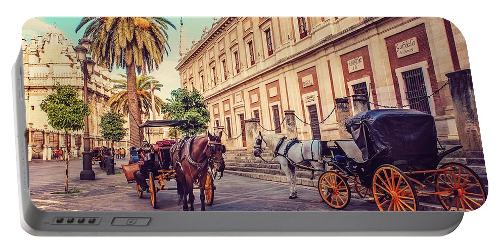 Spain Portable Battery Charger featuring the photograph Noon At Cathedral Square. Seville by Jenny Rainbow