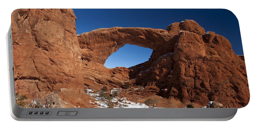 The Windows Portable Battery Charger featuring the photograph North Window Arches National Park Utah by Jason O Watson