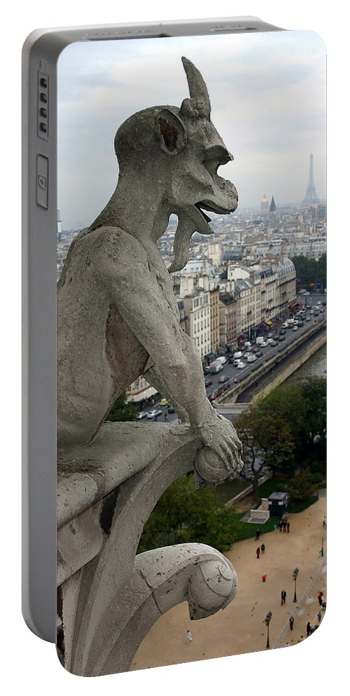 Paris Portable Battery Charger featuring the photograph Notre Dame Gaze by Mike Reid