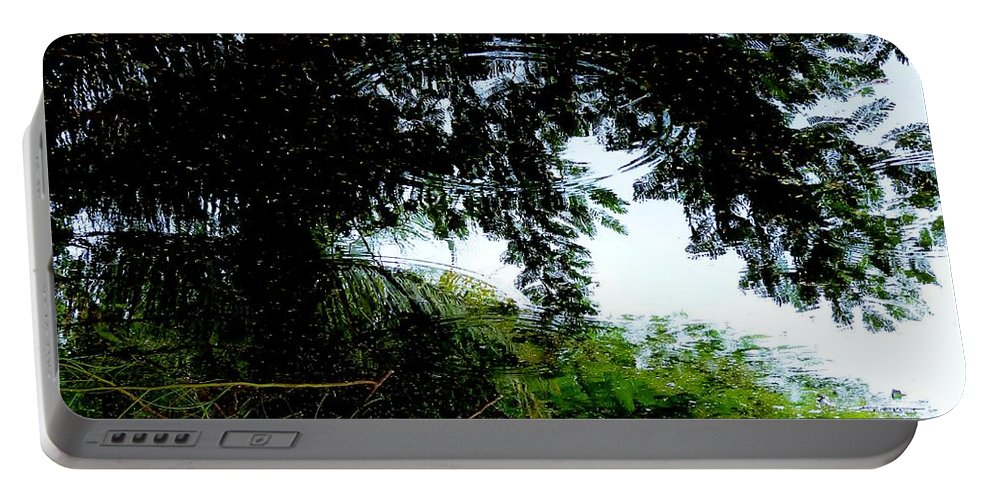 Color Portable Battery Charger featuring the photograph October Rain by Amar Sheow