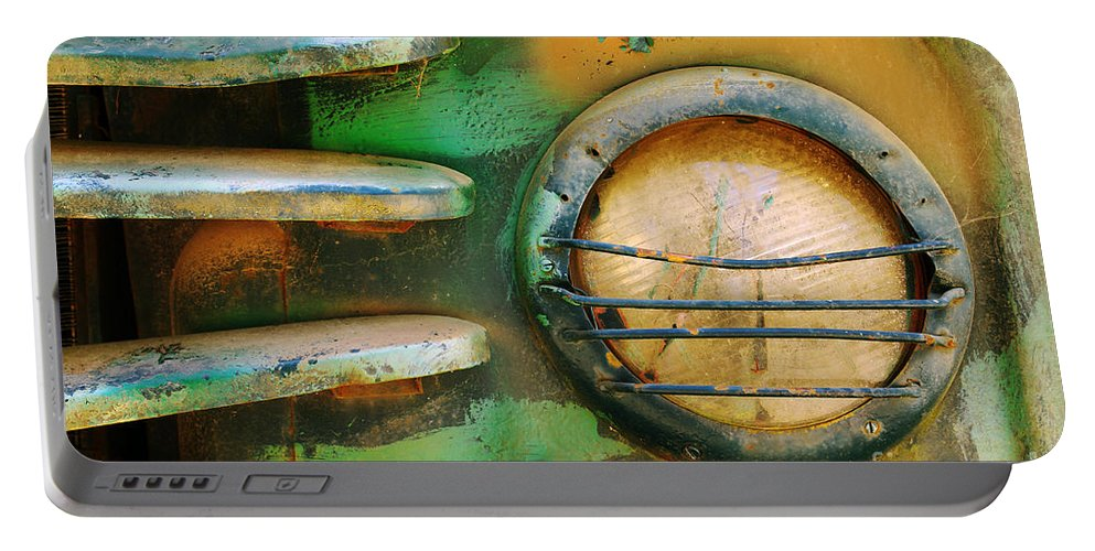 Abandoned Portable Battery Charger featuring the photograph Old Car Headlight by Carlos Caetano