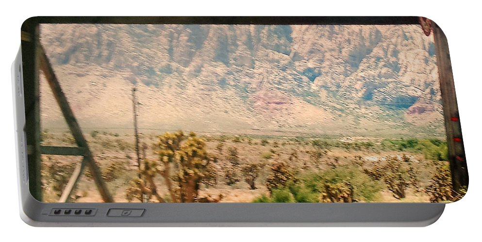 Nevada Portable Battery Charger featuring the photograph Old Nevada Entrance by Lisa Byrne