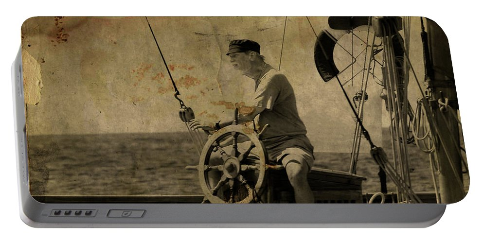 Tall Ship Portable Battery Charger featuring the photograph old sailor A vintage processed photo of a sailor sitted behind the rudder in Mediterranean sailing by Pedro Cardona Llambias