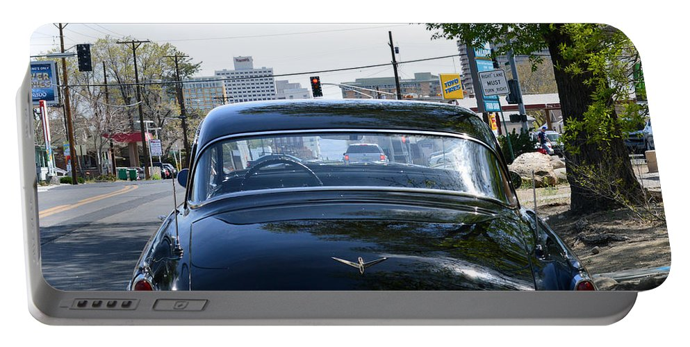 Car Portable Battery Charger featuring the photograph Old Studebaker by Brent Dolliver
