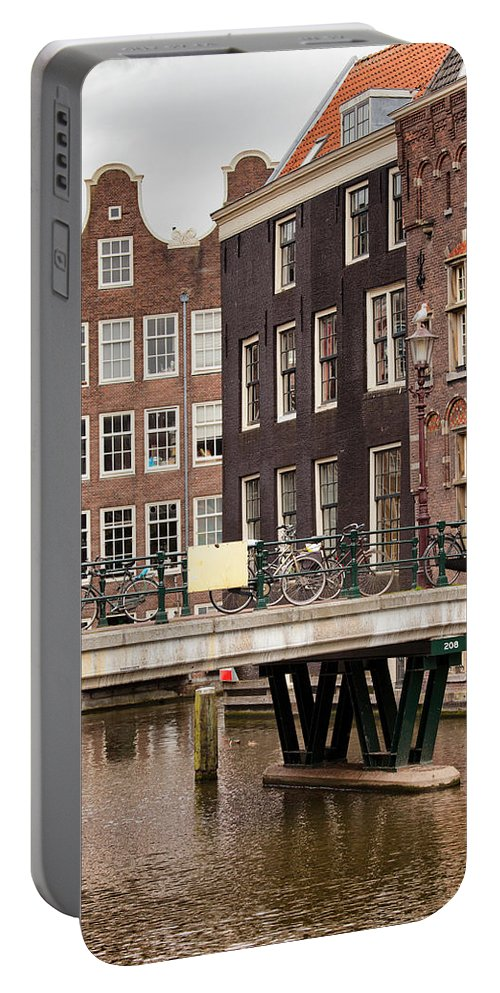 Holland Portable Battery Charger featuring the photograph Old Town In Amsterdam by Artur Bogacki