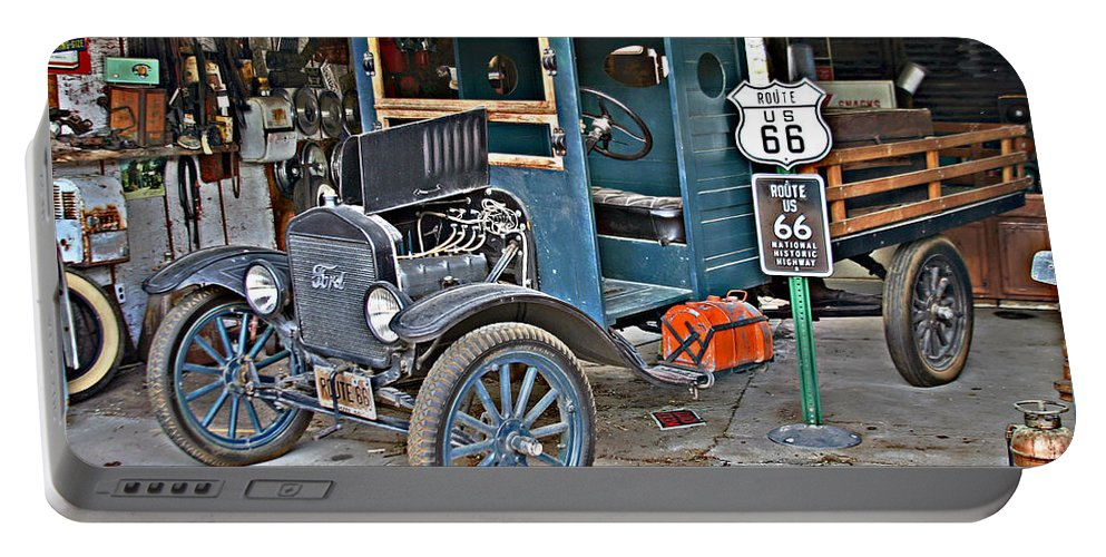 Truck Portable Battery Charger featuring the photograph Old Tyme Auto Shop by Hugh Carino