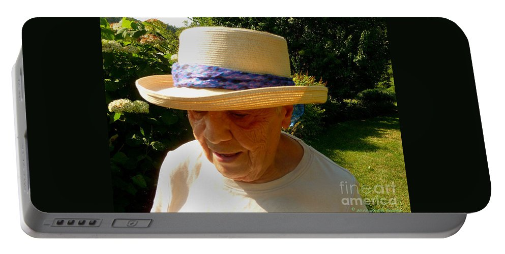 Old Woman Portable Battery Charger featuring the photograph Old Woman Wearing Straw Hat by Afroditi Katsikis