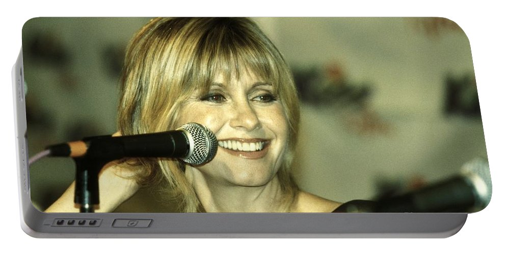 Australian Portable Battery Charger featuring the photograph Olivia Newton John by Concert Photos