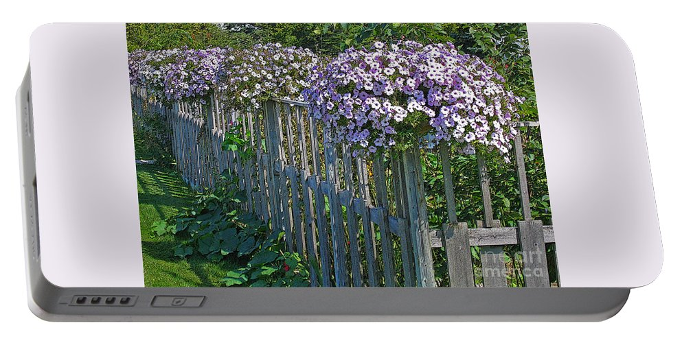 Petunia Portable Battery Charger featuring the photograph On The Fence by Ann Horn