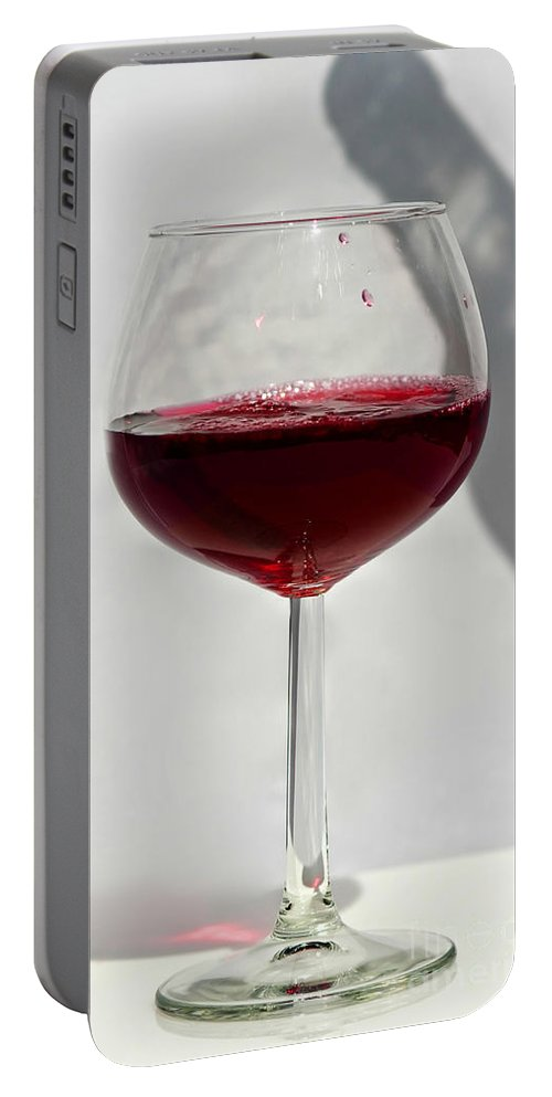 Alcohol Portable Battery Charger featuring the photograph One Glass Of Red Wine With Bottle Shadow Art Prints by Valerie Garner