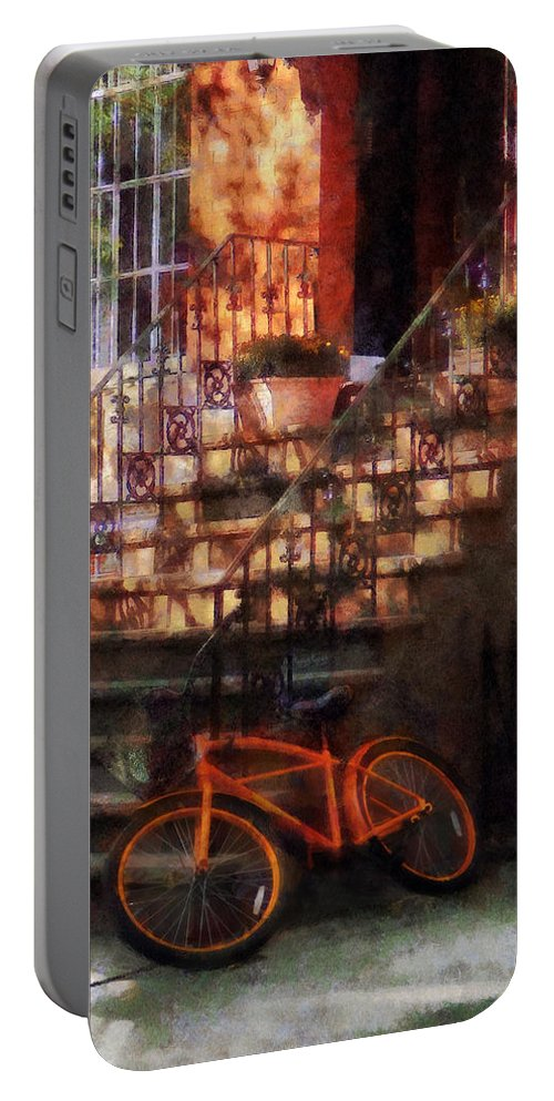 Dappled Sunlight Portable Battery Charger featuring the photograph Orange Bicycle By Brownstone by Susan Savad