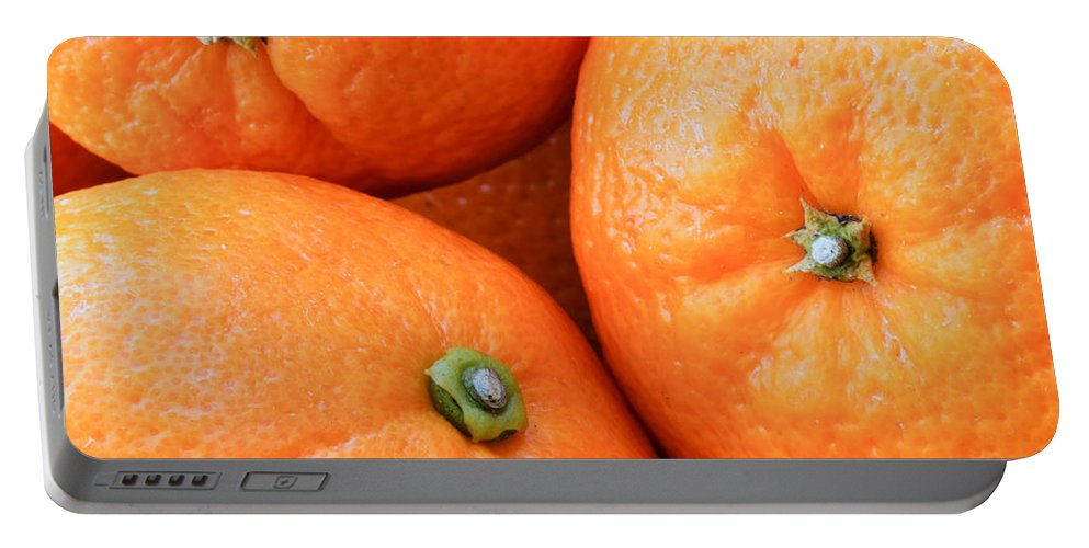 Background Portable Battery Charger featuring the photograph Orange Trio by Heidi Smith