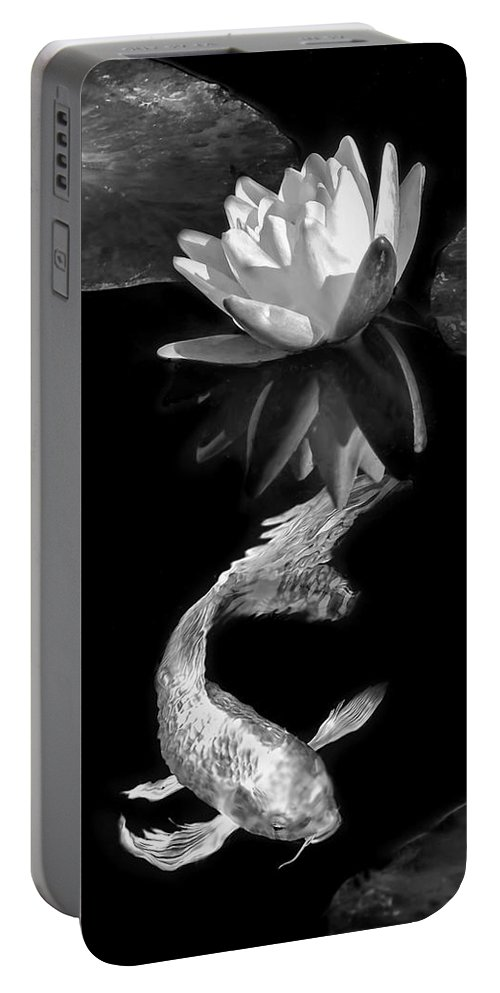 Koi Portable Battery Charger featuring the photograph Oriental Koi Fish And Water Lily Flower Black And White by Jennie Marie Schell
