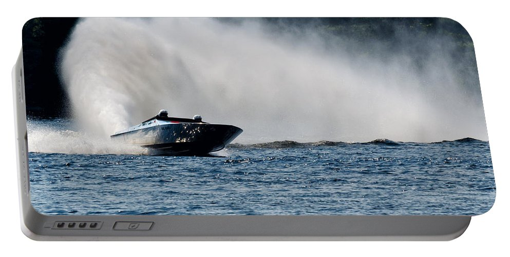 Boat Portable Battery Charger featuring the photograph Out Of The Curve by Les Palenik