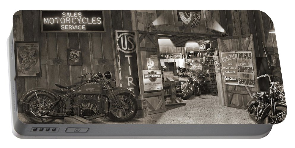 Motorcycle Portable Battery Charger featuring the photograph Outside The Old Motorcycle Shop - Spia by Mike McGlothlen