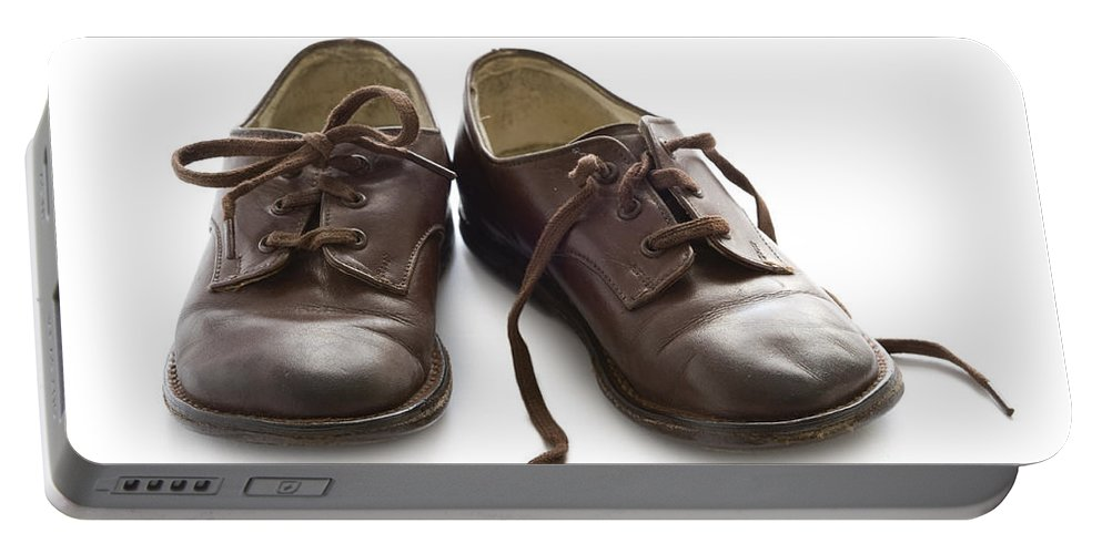 Vintage Portable Battery Charger featuring the photograph Pair Of Vintage Child Leather Shoes by Lee Avison